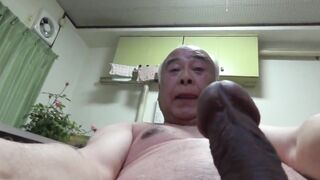 Japanese old man playing with his dick