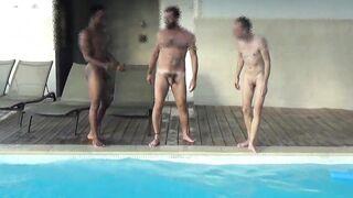 Four men posing at the pool