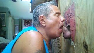 Older man at his self-made gloryhole worships dick